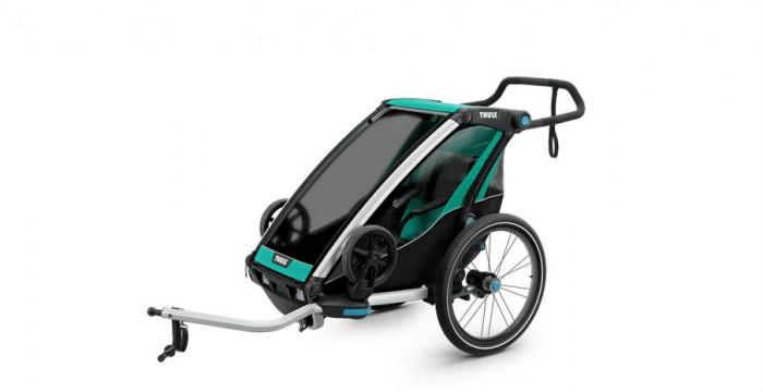 Thule Велоприцеп Chariot Lite 1Аксессуары для велосипедов и самокатов<br>Thule Велоприцеп Chariot Lite 1 для 1 ребенка облегченная всесезонная коляска на каждый день. Совмещает в себе 4 вида активности: бег, прогулки, велосипедные прогулки и лыжи. Прогулочный блок и велосцепка идут в комплекте.  Особенности:    Четыре вида активного отдыха: езда на велосипеде, бег, прогулки пешком и катание на лыжах Прицеп компактно складывается, благодаря чему его можно брать с собой куда угодно Система Thule VersaWing позволяет легко переключаться между различными видами активного отдыха вне зависимости от используемой оснастки Подвеска обеспечит комфортную прогулку вам и ребенку Крепление Thule Click n' Store: удобное размещение снаряжения для прогулки, бега и езды на велосипеде при смене вида активного отдыха Набор для велосипедного крепления входит в комплект.