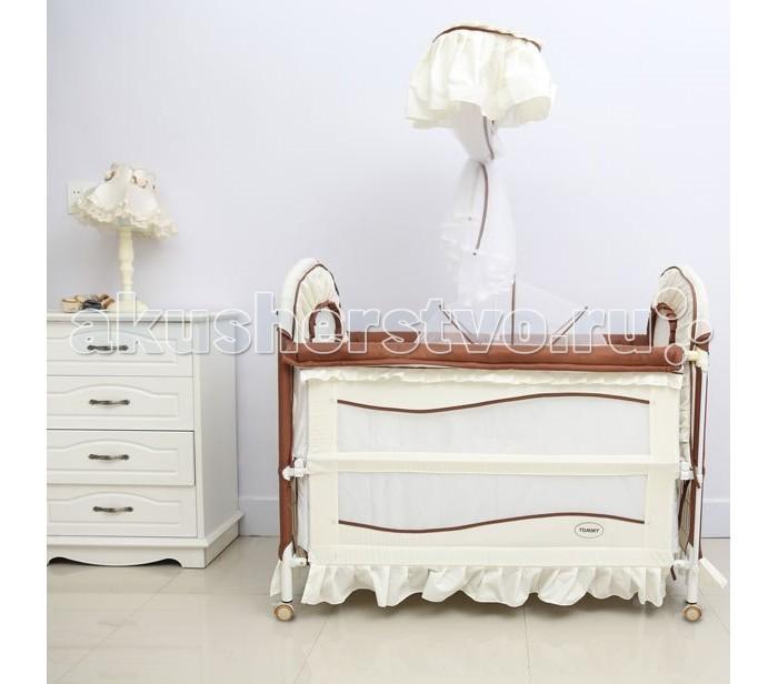 Кроватка-трансформер Tommy Cute LifeCute LifeКровать-трансформер Tommy Cute Life имеет два положения для регулировки по высоте, что очень удобно, так как кроватку можно использовать как манеж.   В комплектацию входят большая колыбель с функцией укачивания. Боковые стенки с легкостью опускаются, что позволяет использования в качестве детского диванчика, также опускается одна из боковых стенок, что позволяет превратить кроватку в пеленальный столик. Кроватка имеет четыре колеса и это удобно без всяких усилий перемещать ее по комнате. Комплектация:  Кроватка маленькая колыбель балдахина крепление для балдахина Размеры (ДхШхВ): 123 х 69 х 107 см   Максимальная нагрузка 35 кг<br>