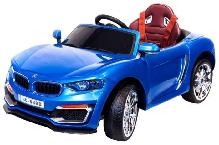 Электромобиль Toyland HC 6688HC 6688Электромобиль Toyland HC 6688 для ребенка от 1 года до 8 лет развивает скорость до 7 км/ч. Открывающиеся двери, огни фар и фонарей, а так же возможность включить свою музыку или радио делают этот электромобиль похожим на такой же, как у взрослых.  Салон автомобиля сразу дает понять, что это машина премиум-класса. Сиденья изготовлены из кожи и имеют удобную спортивную форму. Садясь в машину, ребенок будет чувствовать себя комфортно и уютно. Пристегнуться можно с помощью ремня безопасности. Ваше внимание сразу привлечет наличие панели приборов с подсветкой и автомагнитола. На руле имеются кнопки, отвечающие за регулировку громкости данной музыкальной системы, и клаксон. Также вы сможете переключать любимые треки простым нажатием на соответствующую кнопку. Установленная музыкальная система поддерживает карту памяти, также у нее имеется USB-выход, AUX и радиоприемник.  У модели тщательно проработан вопрос светового оформления. Светодиодные фары машины светятся, как у настоящей. Также имеются габариты и задние фонари. Всего у автомобиля 3 скорости, из которых: две вперед и одна назад. Их переключение осуществляется с помощью пульта ДУ, а для плавного набора скорости просто равномерно нажимайте на педаль газа. Радиус действия пульта дистанционного управления составляет 30 м, работает по Bluetooth.<br>