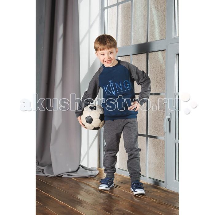 Умка Комплект (толстовка и брюки) М-183Комплект (толстовка и брюки) М-183Умка Комплект (толстовка и брюки) М-183  Спортивный костюм для мальчика сине-серого цвета, толстовка с карманами-кенгуру, брюки с карманами, на резинках из натурального высококачественного хлопкового трикотажа.  Состав: Хлопок 92%, лайкра 8% (футер)  Уход: автоматическая стирка до 40°  Миссия компании Умка – создание яркой, комфортной, качественной одежды, соответствующей тенденциям современной детской моды, для детей в возрасте от 0 до 12 лет по цене, доступной для широкого круга покупателей.  Компания Умка – ответственный производитель, который уделяет максимальное внимание качеству своей продукции. Трикотаж для детей отечественного производства сертифицирован и полностью соответствует всем требованиям, предъявляемым к детской одежде.<br>
