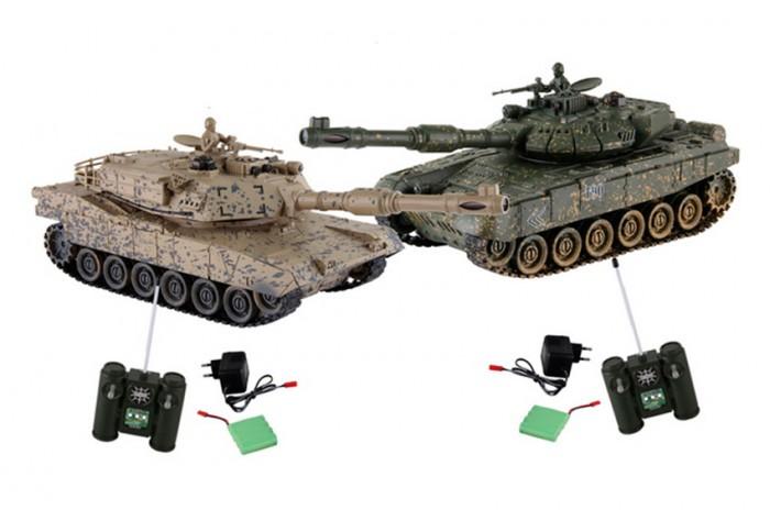 Yako Танковый бой 1:24 М1А2 Абрамс против ТиграТанковый бой 1:24 М1А2 Абрамс против ТиграТанковый бой YAKO М1А2 Абрамс против Тигра  В качестве снарядов танки выстреливают инфракрасными лучами на расстояние до 3 м. При выстреле происходит звуковая соответствующая имитация. У каждого танка, на задней стороне башни есть 4 светодиода - жизни машины.   Цель игры - уничтожить танк неприятеля. При попадании по танку его жизни уменьшаются - потухает светодиод, если все светодиоды потухли, значит Вы проиграли и танк больше не сможет исполнять Ваши сигналы. Так же следует отметить, что два танка имеют различные характеристики, но в целом силы равны.   Особенности:   Частота 27 МГц (А/С)  В наборе 2 танка 1:24.   Пушка с инфракрасным излучаетелем.   Индикатор уровня жизни.   Радиус действия пульта - 12 м.   Радиус передачи ИК сигнала - 8 м.   Время работы 15-20 минут.   Время зарядки - 4 часа.   Скорость танка - 6 км/ч.   Демо режим.   Функция автоотключения.   Имитация отката при выстреле.   Движение танка во все стороны.   Поворот башни на 320 градусов. Подъём на наклонную поверхность при угле наклона - до 45 градусов.   Световые и звуковые эффекты. Звук двигателя и выстрелов.   Питание танка от аккумулятора (в комплекте) Ni Cd 600 mAh 4,8V.  Питание пульта управления - от 2-х батареек типа АА (нет в комплекте).<br>