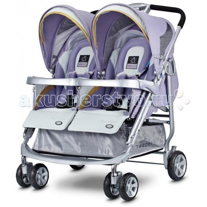 Zooper Коляска для двойни Tango SmartКоляска для двойни Tango SmartZooper Коляска для двойни Tango Smart – самая легкая прогулочная коляска для двойни, всего 12,7 кг. Может использоваться с рождения (есть специальный вкладыш для новорожденного) до трех лет. Спинки опускаются на 180 градусов независимо друг от друга, широкие сиденья.  Особенности: новый улучшенный большой капюшон теперь по всех колясках Zooper. Новый дизайн универсального капюшона Zooper сочетает в себе: UV-сетку, дождевик и козырек от солнца в одном блоке. Теперь, капюшон имеет всё необходимое, чтобы оградить вашего ребенка от дождя, солнечного света и ультрафиолетовых лучей, избавляя вас от неприятностей теплая муфта для ног защищает вашего малыша от ветра и дождя и держит в тепле ножки малыша в любую погоду. Когда становится совсем холодно, вам не о чем беспокоиться, ребенок как будто укутан одеялом и риск простудиться сводиться к минимуму не имеет значения какая погода на улице, ваш малыш будет полностью защищен от внешнего воздействия подголовник, специально спроектированный для новорожденных, сделан из мягкого и комфортного материала, чтобы вашему ребенку удобно было спать новорожденный у вас или постарше, пятиточечные ремни безопасности обеспечат максимальный комфорт и исключают возможность зажима детально продуманный дизайн обеспечивает ребенку максимальную защиту. Бортики в коляске предотвратят падение малыша трехпозиционная регулируемая подставка для ножек позволяет находится в лежачем и сидячем положениях четыре независимых амортизатора на каждом колесе это стандарт, он есть во всех колясках Zooper удобный карман на внешней стороне капюшона позволит взять с собой на прогулку все необходимое, при этом облегчит и маме жизнь большая корзина поможет освободить руки и сложить все необходимое с собой на прогулку или покупки из магазина подстаканник разработан для чашек/стаканов различных размеров, это позволит вам взять кофе и завтрак с собой управление одной рукой, в случаях, когда вам нужно де